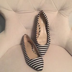 Express black and white stripped flats.